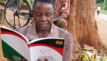 A Kenyan lady reading the Constitution