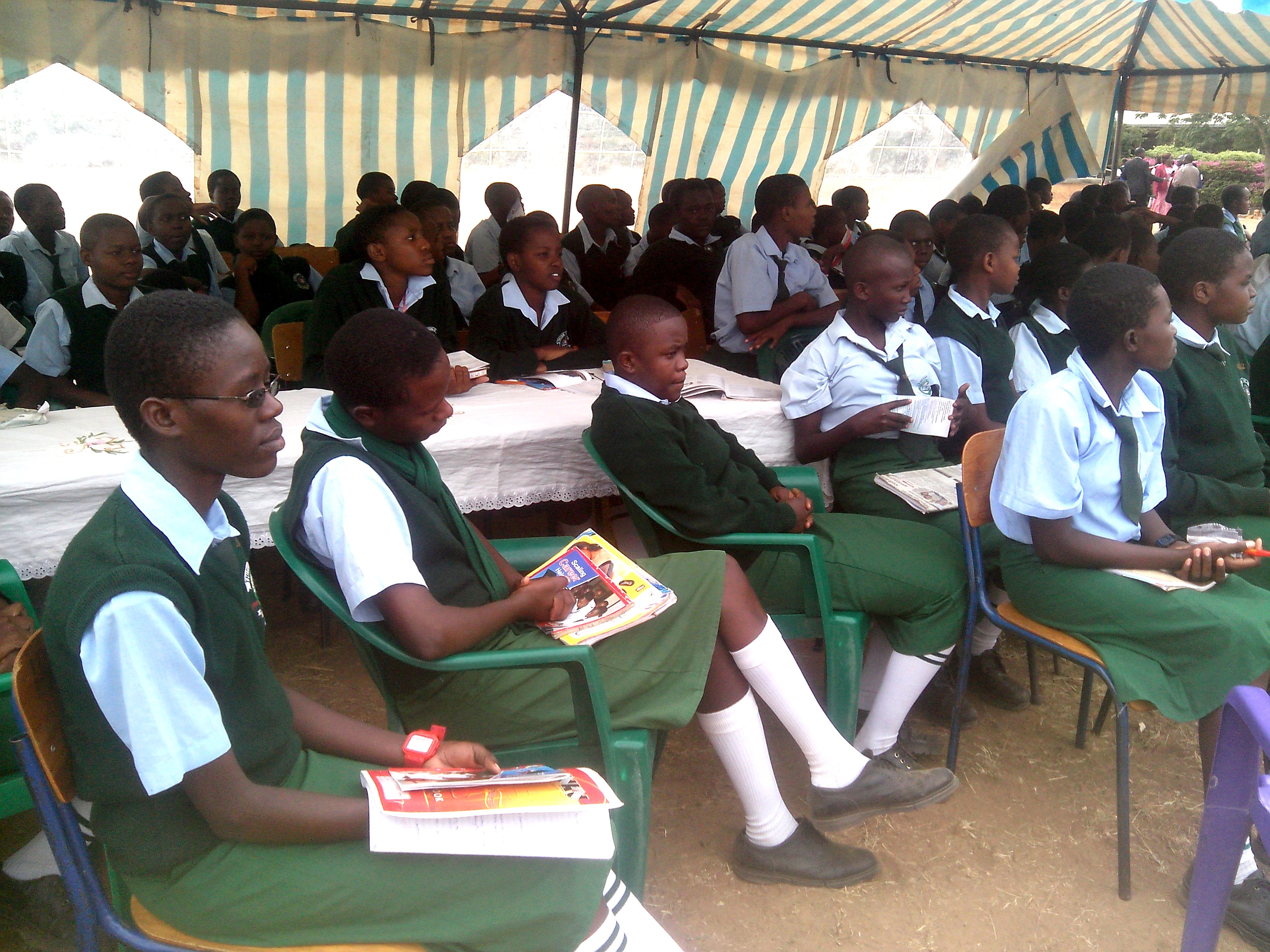 Thitani Girls Secondary school students in Kitui county follow speeches during a recent career day in the school