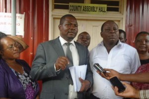 Tharaka Nithi finance executive Mate Murithi (Left) and County assembly Budget and appropriation Committee chairman Karani Laban in white shirt. Photo courtesy of www.the-star.co.ke
