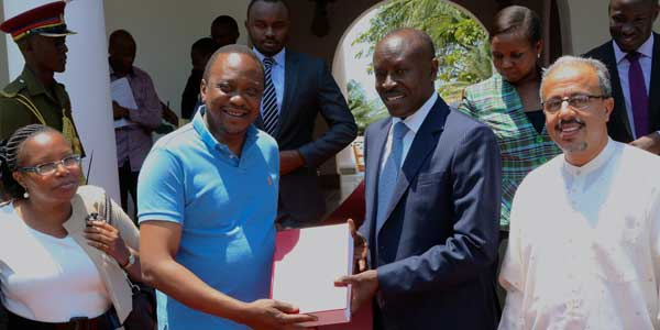 President Uhuru Kenyatta receves the findingd of the commission of inquiry inrom to the posssibe dissolution of Makueni County from commission chair Mohammed Nyaoga  at Satehouse in Mombasa Photo:
