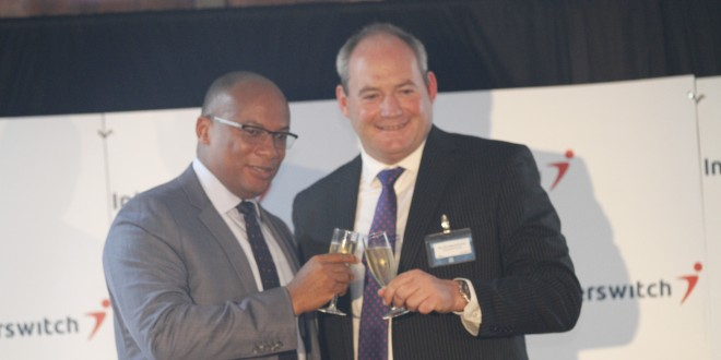 Interswitch Group CEO Mitchell Elegbe (L) and Bernard Matthewman, Interswitch East Africa CEO (formerly Paynet Group CEO) toast to a new logo during the launch of Interswitch East Africa. Paynet Group which owns PesaPoint network is now Interswitch East Africa. [Photo: Kamau Ngunyi/ Wheels Media]