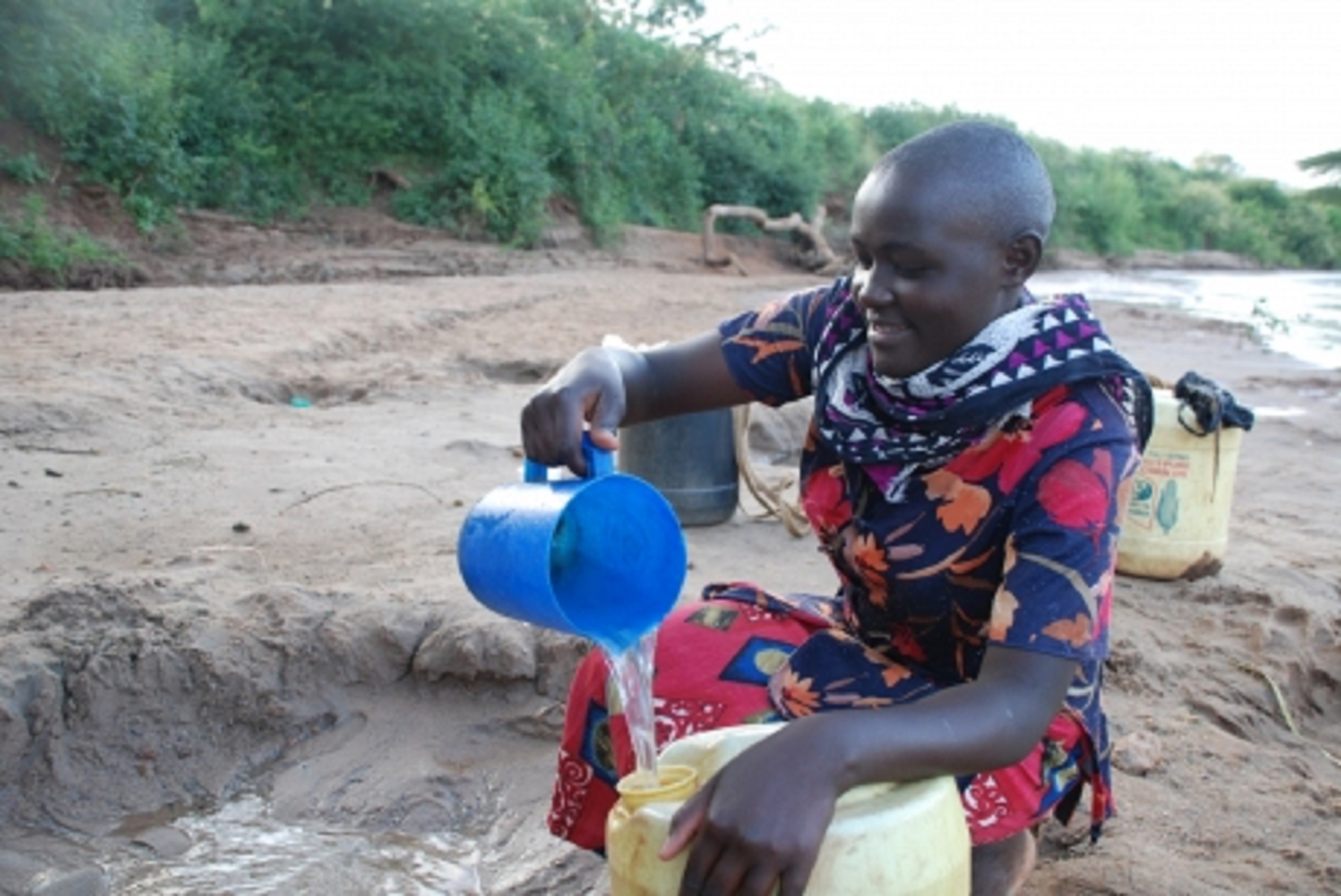 Mauren Saumo fetches water from Isiolo River. The river is transforming agriculture in the area. [Photo: Malachi Motano]